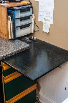 "This slide out shelf enables extra space on the ""dry side"" of the darkroom, for inspecting negatives, etc."