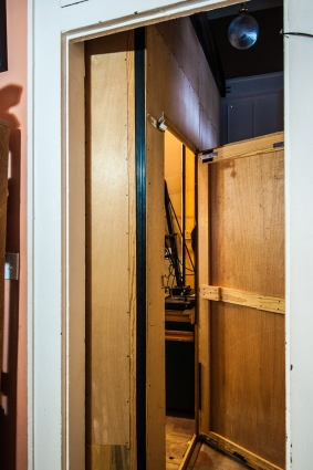 "The ""false wall"", with door, that I built to enclose the darkroom creates a narrow hallway for passage.  Originally equipped for hinges for anytime conversion, I never break it down."